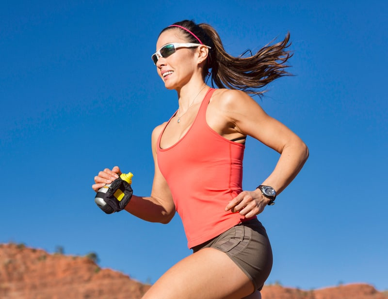 Woman running without headphones