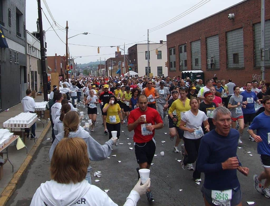 Water stops can get crowded in a marathon.